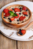 Tasty oatmeal with berries — Stock Photo