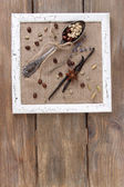 Wooden frame, vintage spoon and spices on wooden background — Stok fotoğraf
