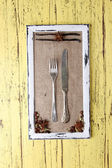 Wooden frame, spices and vintage cutlery  on color wooden background — Stock Photo