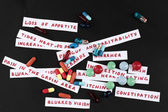 Prescription drug lottery on black background, close-up — Zdjęcie stockowe