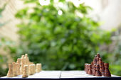 Chess board with chess pieces on bright background — Foto de Stock