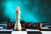 Chess board with chess pieces on light blue background — Foto de Stock
