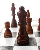 Chess board with chess pieces isolated on white — 图库照片