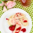 Tasty  sweet dumplings with fresh strawberry on white plate, on bright background — Stock Photo #49425305