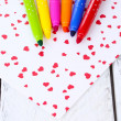 Bright markers with paper on wooden table close-up — Stock Photo #49428619