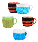 Cups with knitted thing on it isolated on white — Stock Photo
