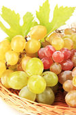 Ripe sweet grape in basket, isolated on white — Stock Photo