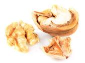 Broken walnut isolated on white — Stock Photo