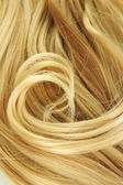 Curly blond hair close-up background — Stock Photo