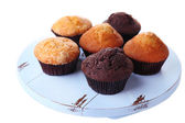 Tasty muffins on wooden tray isolated on white — Stock Photo