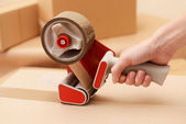 Packaging parcels with dispenser close-up — Stock Photo