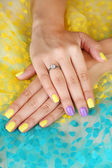 Female hand with stylish colorful nails, on bright background — Stock Photo
