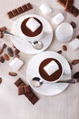 Cups of hot chocolate on table, close up — Stock Photo