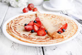 Delicious pancakes with berries on table close-up — Stock Photo