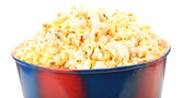 Popcorn in striped bucket isolated on white — Stock Photo