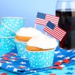 American patriotic holiday cupcakes and glass of cola on blue background — Stock Photo #49444831