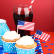 American patriotic holiday cupcakes and glass of cola on red background — Stock Photo #49444851