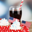 American patriotic holiday cupcakes and glass of cola on wooden table — Stock Photo #49444891