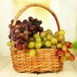 Fresh grape on wicker mat on bright background — Stock Photo #49453809