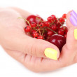 Female hands with stylish colorful nails holding ripe berries, isolated on white — Stock Photo #49454767