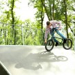 Young boy jumping with his BMX Bike at skate park — Stock Photo #49455369