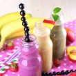 Bottles of delicious smoothie on table, close-up — Stock Photo #49455543