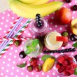 Bottles of delicious smoothie on table, close-up — Stock Photo #49455559