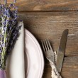 Dining table setting with lavender flowers on wooden table background — Stock Photo #49456161