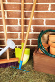 Tools of gardener on  bricks background — Stock Photo