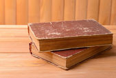 Old books on table on wooden background — Stock Photo