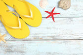 Few summer items on wooden background — Stock Photo