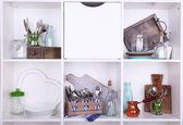 Kitchen utensils and tableware on beautiful white shelves — Stok fotoğraf