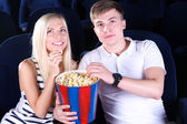 Young couple watching movie in cinema — 图库照片