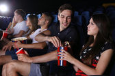 Young people watching movie in cinema — Stockfoto