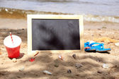 Blank chalkboard on beach background — Stock Photo