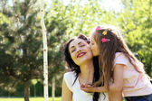 Happy mom and daughter. Walk in the green park — Stock Photo