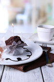 Chocolate muffin with chocolate sauce — Stock Photo