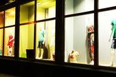 Fashion show in store window — Stock Photo