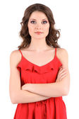 Beautiful young girl in red dress isolated on white — Stock Photo