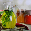 Essential Oil with rosemary in glass jug — Stock Photo #49527045