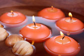 Beautiful candles in water close-up — Stock Photo