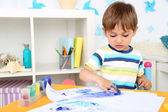 Cute little boy painting in room — Stock Photo