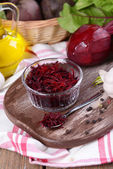 Grated beetroots in bowl — Stock Photo