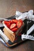 Piece of strawberry tart on tray — Stock Photo