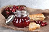 Berries jam in glass jar — Stock Photo