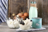 Dairy products and fresh eggs  on wooden background — Foto Stock