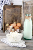 Dairy products and fresh eggs  on wooden background — Stock Photo