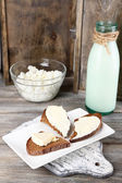 Dairy products: milk, butter, cottage cheese on wooden background — Photo