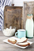 Dairy products: milk, butter, cottage cheese on wooden background — Stock Photo