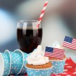 American patriotic holiday cupcakes and glass of cola on wooden table — Stock Photo #49559175